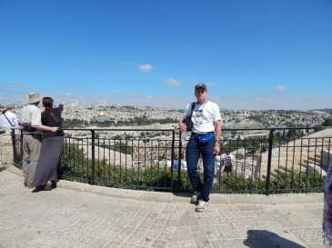 At the overlook on the Mt. of Olives with a view of the Old City walls as well as modern Western Jerusalem in the distance.
