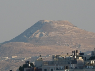 View from the walk from my apartment to my bus stop of The Herodian--Herod the Great's desert fortress from the 1st century BCE. https://en.wikipedia.org/wiki/Herodium